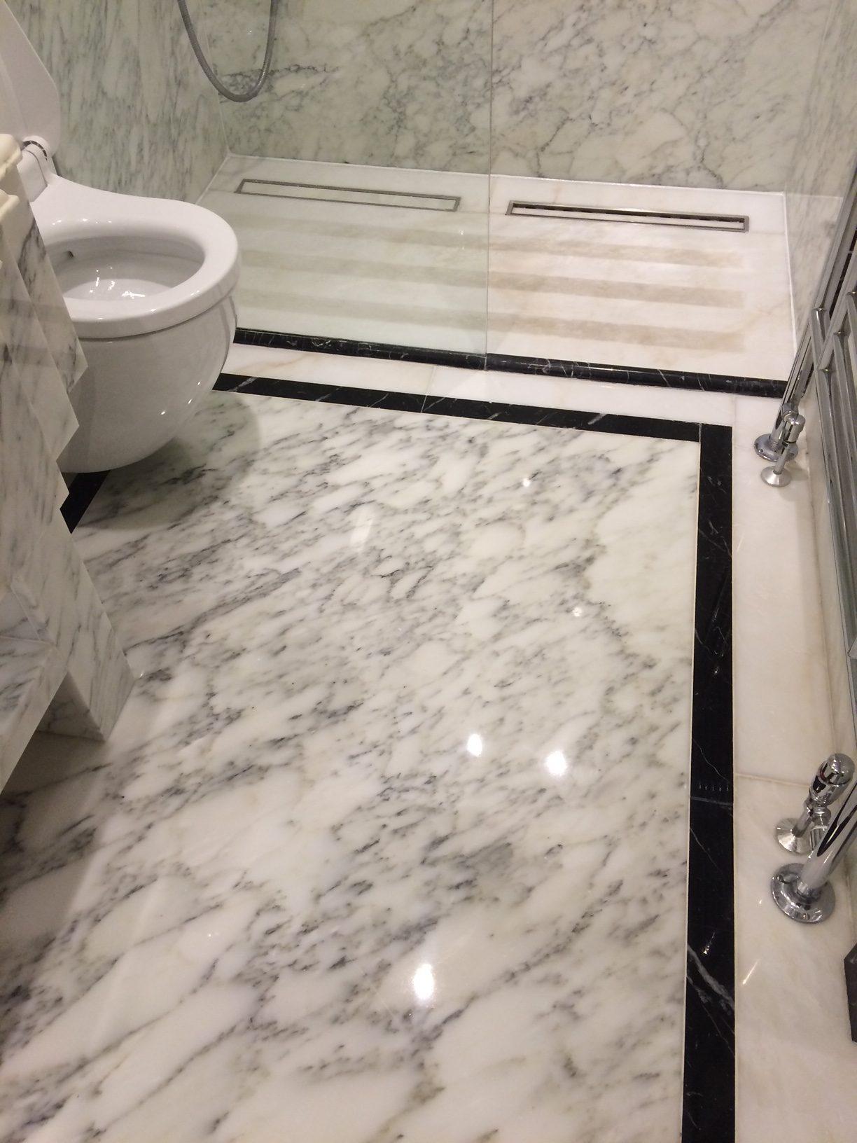 Marble bathroom floor after polishing